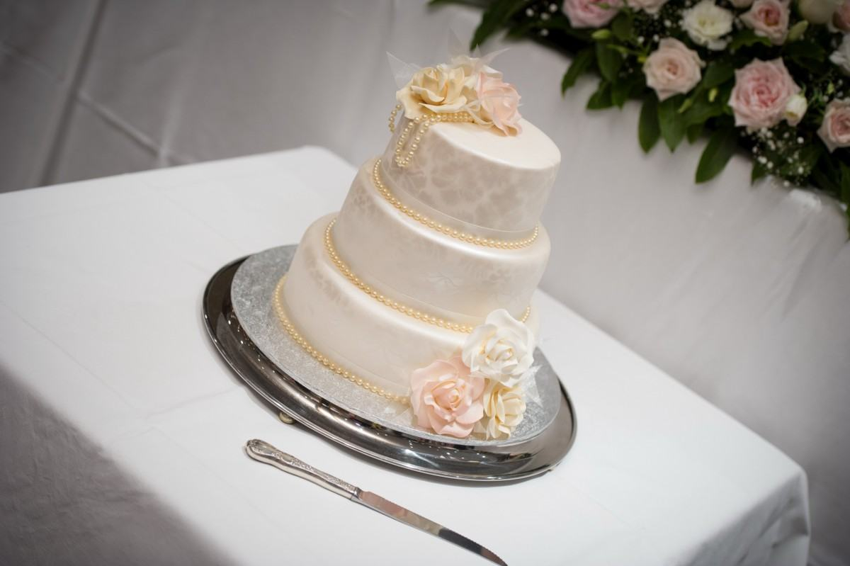 Photo of a wedding cake decorated with pearls