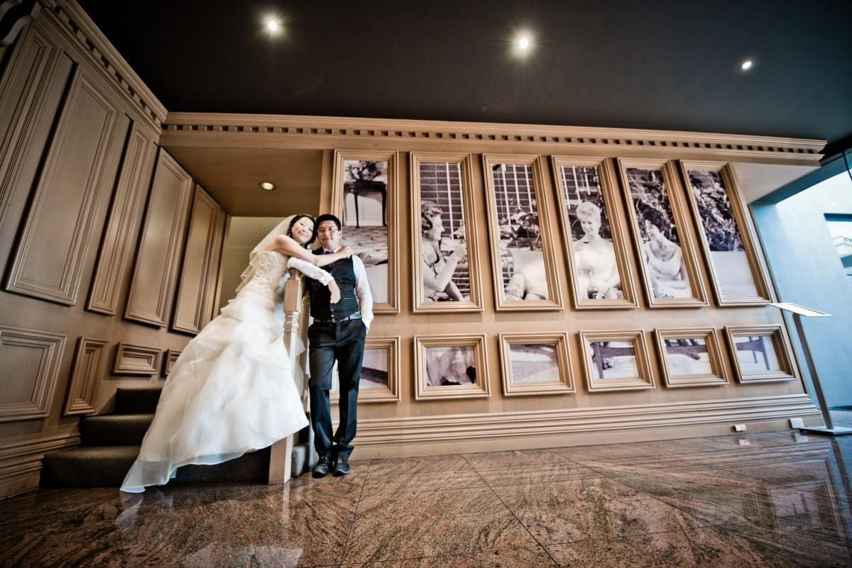 Bride and groom posing in the foyer at Brighton Savoy
